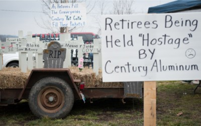 A makeshift cemetery sits prominently at the retirees protest camp, each cross representing a fellow retiree that has passed away since Century Aluminum cancelled their healthcare insurance in 2010, after the company suspended operations at the facility.