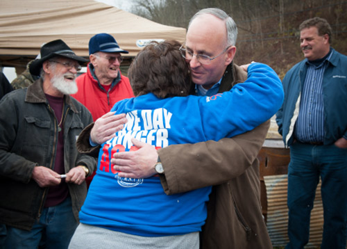 Mama K and Century Aluminum CEO Michael Bless hug after a meeting at the camp in front of the Century facility in February 2012. The visit came one month before the retirees and Century Aluminum finally reached a deal for the return of their benefits, Century's CEO Michael Bless and V.P. of North American Operations John Hoerner were at their encampment to listen to their grievances. Although the talk was heated and emotional at times during his visit, both Karen and Bless hugged and thank each other for their honest and open discussion.