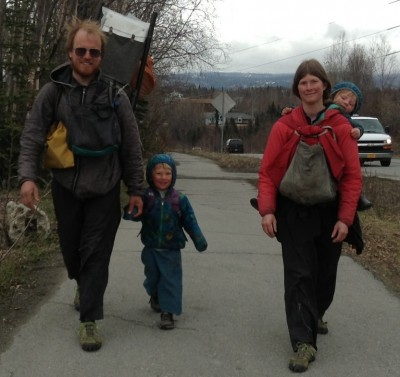 Ground Truth Trekkers Erin and Hig walking with son Katmai and daughter Lituya getting a ride