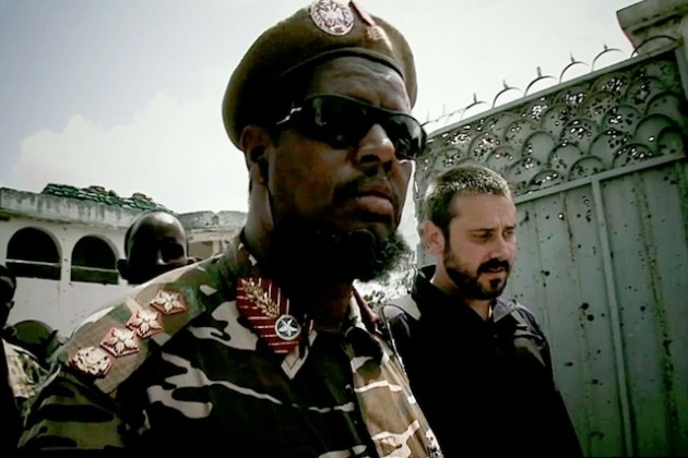 "Dirty Wars reporter Jeremy Scahill with Somali warlord ""General"" Indha Adde, AKA ""White Eyes"". (Photo courtesy of Richard Rowley and Big Noise Films.)"