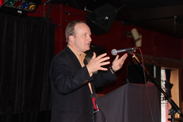 Paul Begala speaks to a group of Democratic supporters at The Taproot, in Anchorage, Alaska.