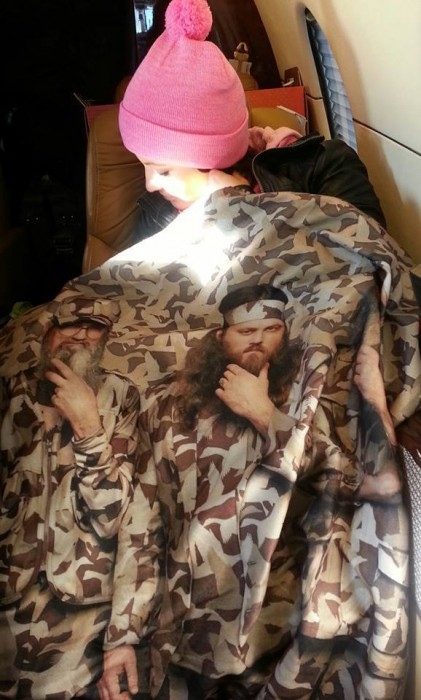 From Sarah Palin's facebook page. One of the Palin Clan wraps themself on a private plane in a Duck Dynasty blanket.