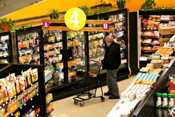 A Co-op Market shopper peruses Roberts-approved inventory.