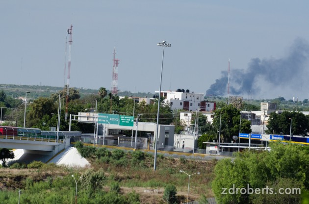 A fire burns on the Mexican side of the border.