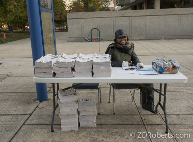 A volunteer with Moral Monday and takes peoples info and distributing voter guides in Greensboro, North Carolina.