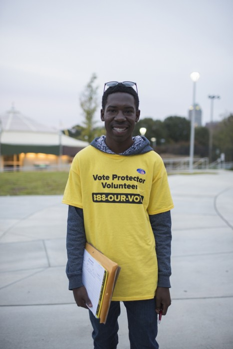 A voter protction volunteer stands outside a polling place in Raleigh. North Carolina.