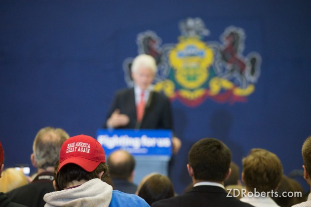 """Trump supporters wearing the iconic """"Make America Great Again"""" hats at a  Hillary Clinton rally with Bill Clinton in Scranton, PA on April 7, 2016."""