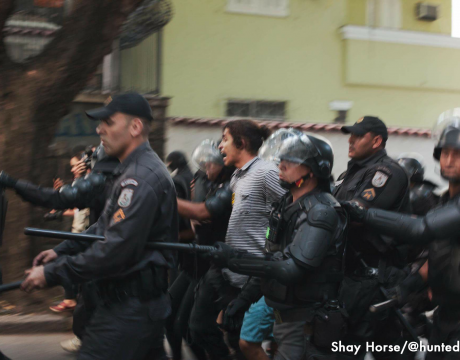A protester being arrested after a clash between the protesters and the Military Police.