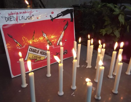 "Indian journalists and cartoonists protested and expressed solidarity with victims of attack on a Paris-based media house ""Charlie Hebdo"" by drawing their creations and lighting candles in New Delhi, main visual by Cartoonist Shekhar Gurera  Photo by Pk4wp"