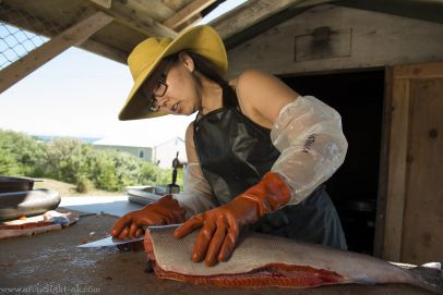 cutting salmon at fish camp